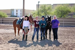 Adaptive Riding Students & Volunteer- Photo Credit Horses Help & 85086 Magazine